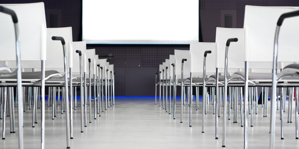Chairs on a row at conference for hotel events