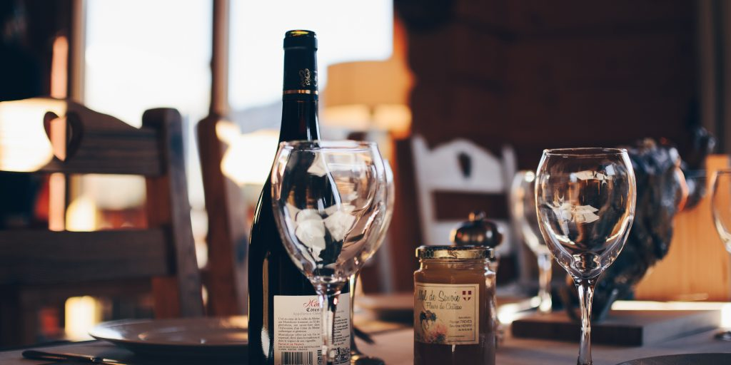 Wine bottle and glass on restaurant table