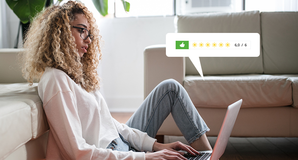 Woman writing a hotel review on a laptop analyzing google reviews