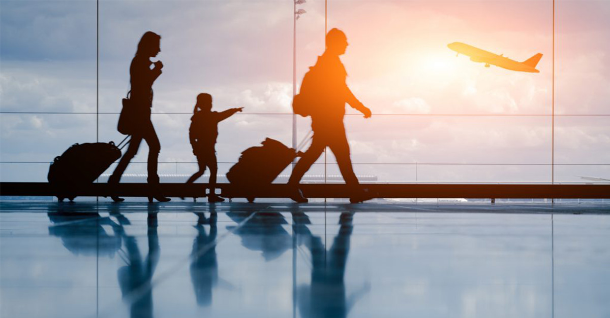 A family ready to board a plane to go on holiday
