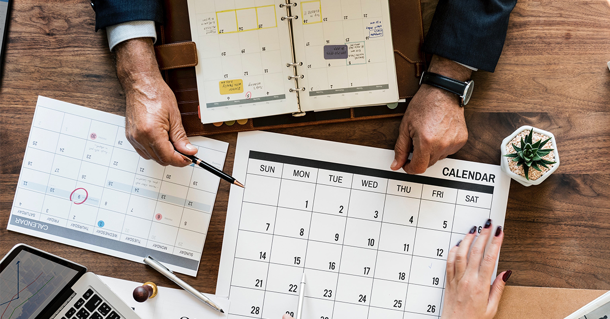 A man planning a meeting at the stand of ReviewPro in a calendar