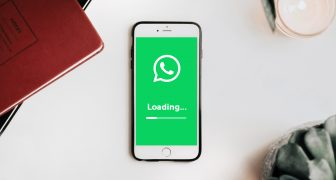 WhatsApp icon on phone, loading