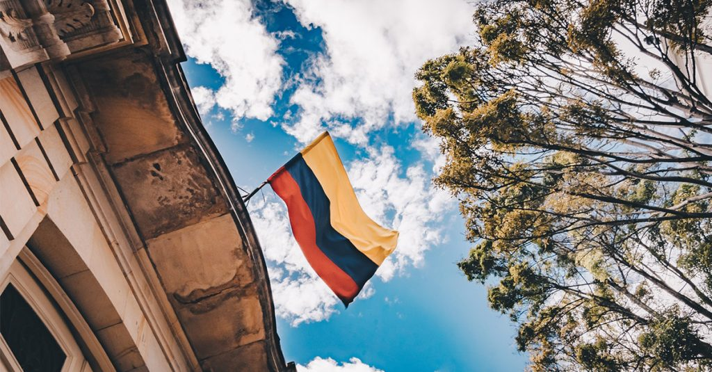Colombia flag against blue sky