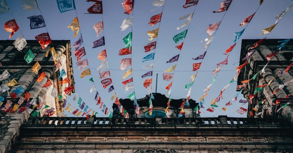 coloured flags blowing in wind