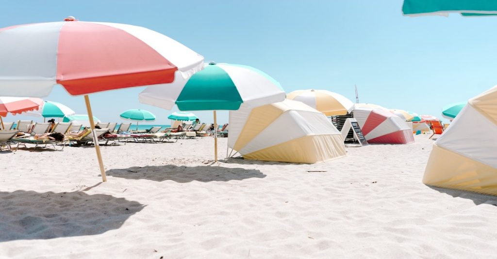 Sunny Miami beach with colorful umbrellas