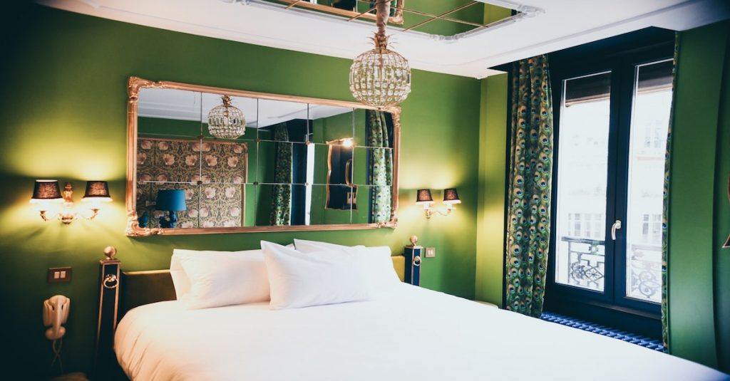 A luxurious boutique hotel room with a large mirror on the wall