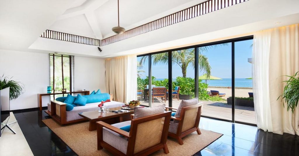 modern hotel room with a sunny beach view