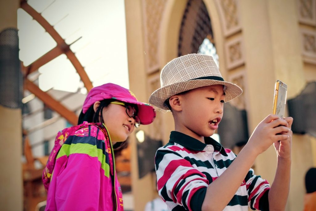 Kids are taking a selfie on vacation
