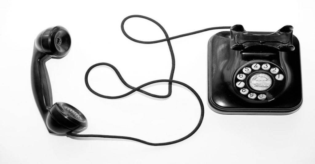 Retro black and white phone with cable