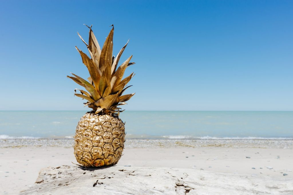 pineapple on the beach in The Caribbean