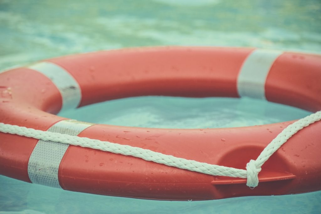 red lifesaver in a pool