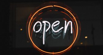Neon sign saying open
