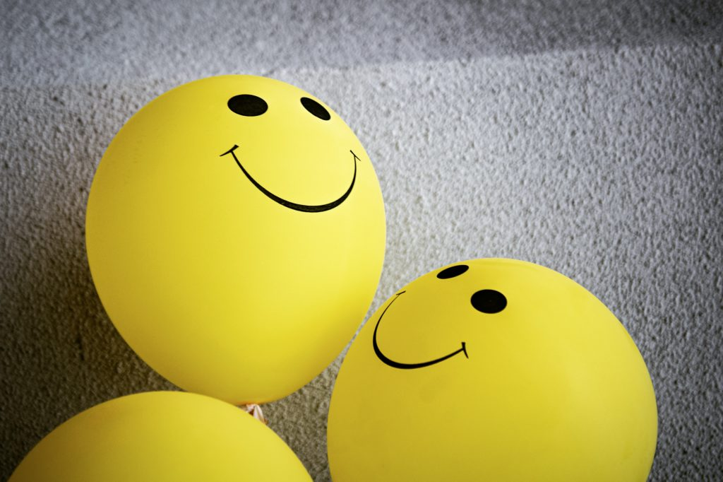 Yellow balloons illustrated with smileys